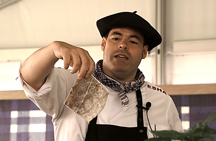 Chef Igor Ozamiz Goiriena shows the crowd a loin of salt cod that has been soaked and rehydrated in cold water. Ralph Rinzler Folklife Archives