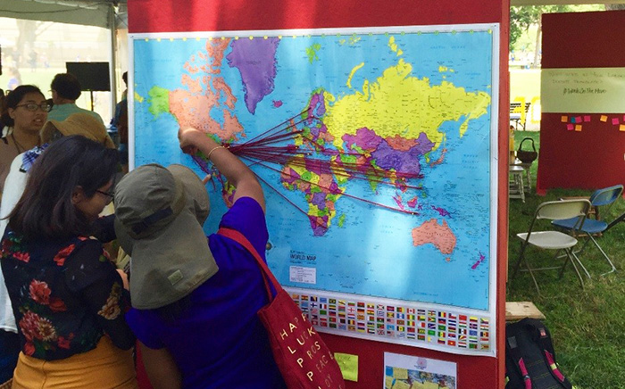 Visitors map their families' journeys to the United States. Photo courtesy of Raquel Escobar and Priscila Hernandez